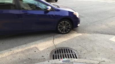 car near storm drain